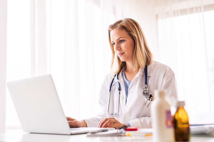 Woman doctor accessing medical records